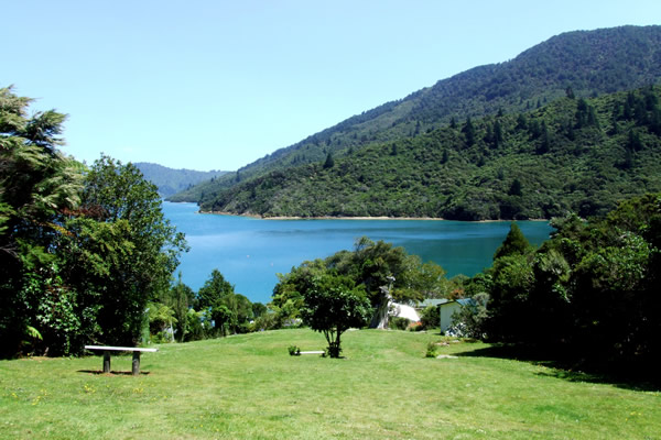 Queen Charlotte Track - Point 7 - Looking out over the lawn at Furneaux Lodge - Copyright Freewalks.nz