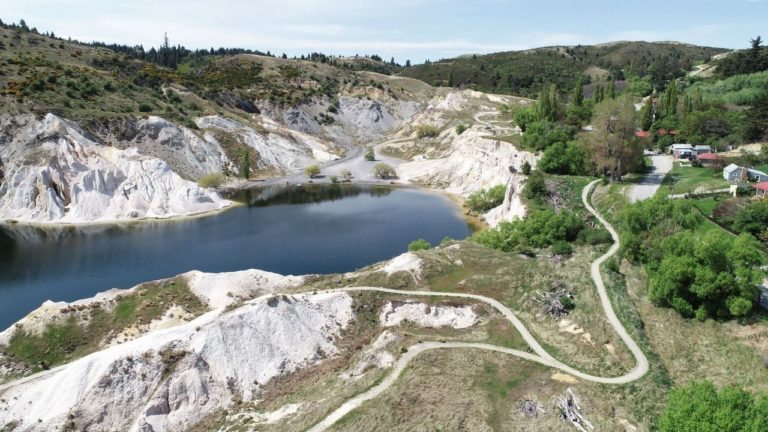 Drone view of the loop walk around St Bathans Blue Lake
